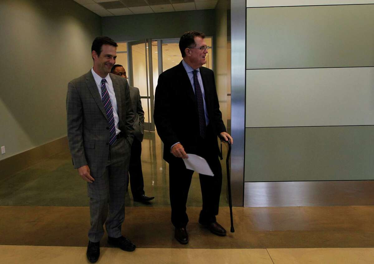 """Houston ISD Superintendent Terry Grier and HISD Spokesman Jason Spencer walk toward the podium Thursday, Sept. 10, 2015, in Houston. Grier announced that he is stepping down effective on March 1. Grier became superintendent of Houston in 2009, leading the nation's seventh largest school district to win the Broad Prize for Urban Education in 2013. """"You can't be school superintendent in Houston forever,"""" Grier said, citing his age and recent knee replacement. """"It's just time and that's it in a nutshell."""""""