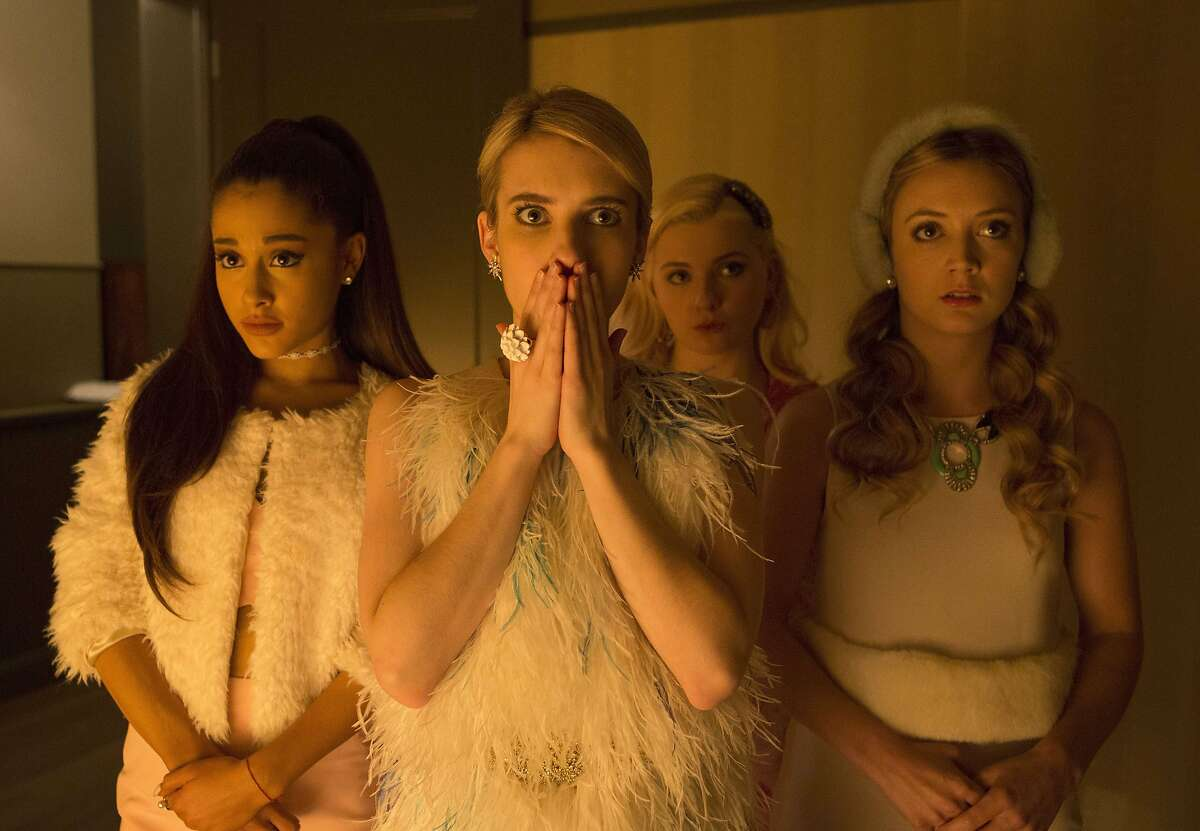"""In this image released by Fox, Ariana Grande, from left, Emma Roberts, Abigail Breslin and Billie Lourd appear in a scene from """"Scream Queens."""""""