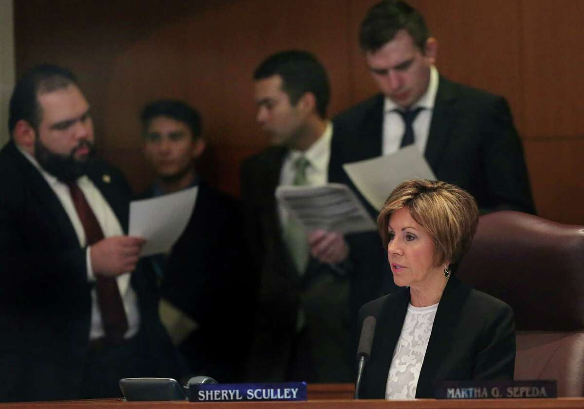 San Antonio City Manager Sheryl Sculley, right, presents the city budget to City Council members as they meet in City Council Chambers on Thursday, September 10, 2015, to vote on the proposed city budget which includes an increase in wages of the lowest-paid city employees to $13 an hour. Behind Sculley are Council Member aids looking over the budget.