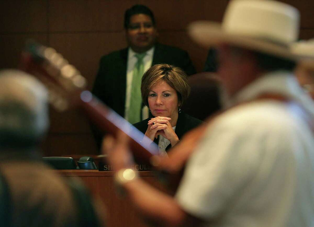 San Antonio City Manager Sheryl Sculley, center, listens to Rodolfo Lopez and others from Conjunto Heritage Taller as they play during City Council Members on Thursday, September 10, 2015. City Council voted on the proposed city budget which includes an increase in wages of the lowest-paid city employees to $13 an hour, and money to help rebuild Lerma's Nite Club where the band plays.