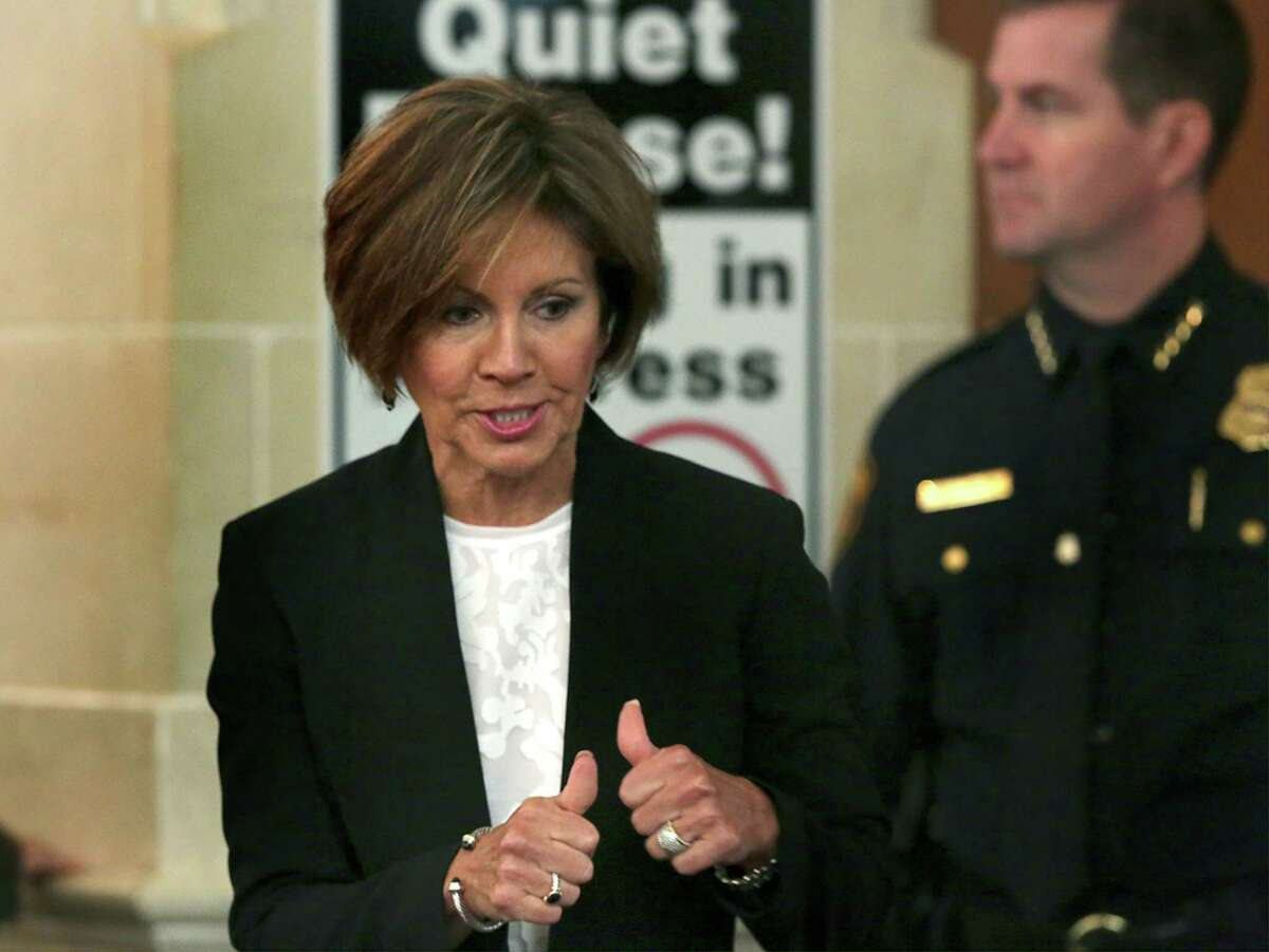In this file photo, San Antonio City Manager Sheryl Sculley, right, gives thumbs up to supporters after the City Council voted in favor of the proposed city budget she presented last September. If you believe in the fight Sculley has waged, then you can't be cowed by her contract or the prospect of a raise.