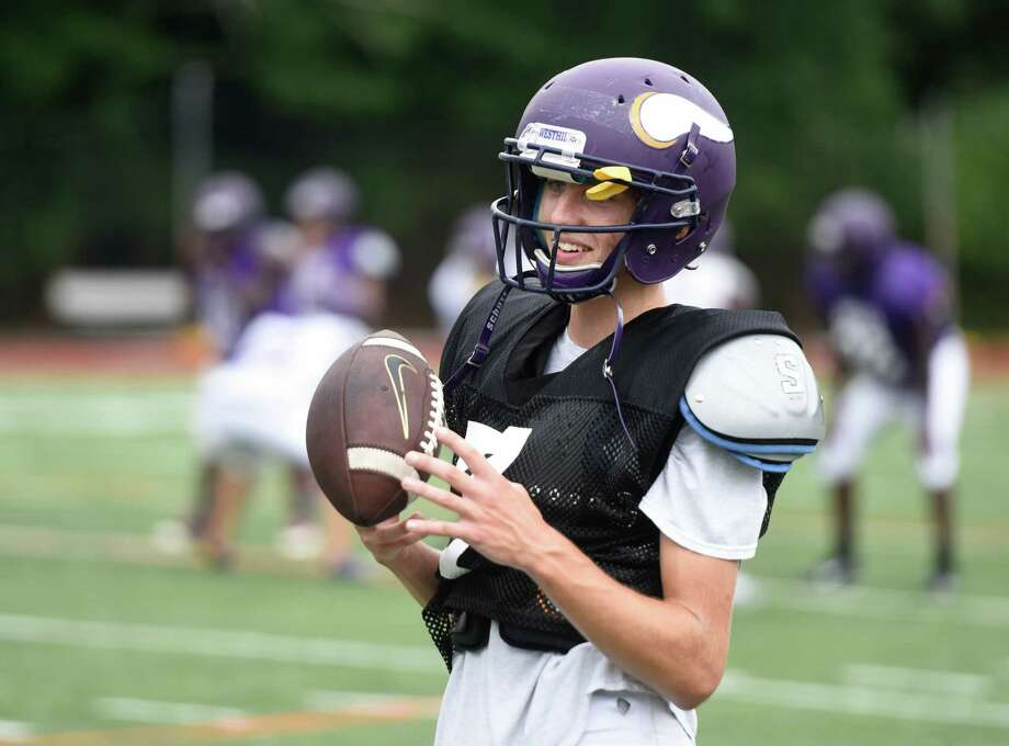 Quarterback Blake Newcomer stands on the sidelines during football practice at Westhill High School in Stamford, Conn. Thursday, Sept. 10, 2015. Photo: Tyler Sizemore / Hearst Connecticut Media / Greenwich Time