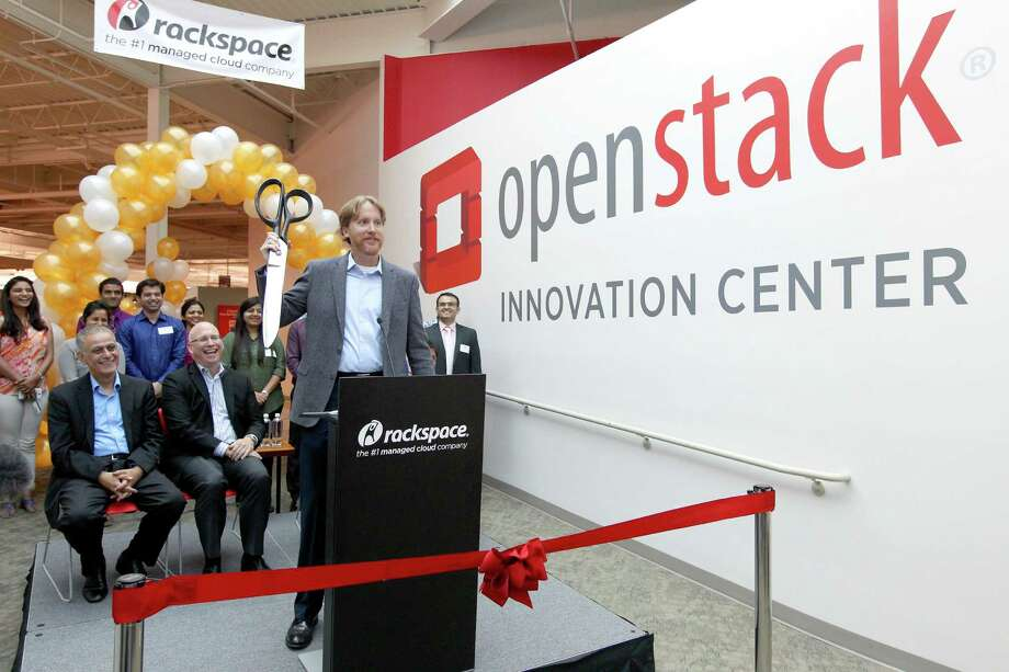 Darrin Hanson, vice president and general manager of Rackspace Private Cloud, holds a giant-sized pair of ceremonial scissors Thursday for the ceremony marking the opening of the OpenStack Innovation Center. Photo: William Luther /San Antonio Express-News / © 2015 San Antonio Express-News