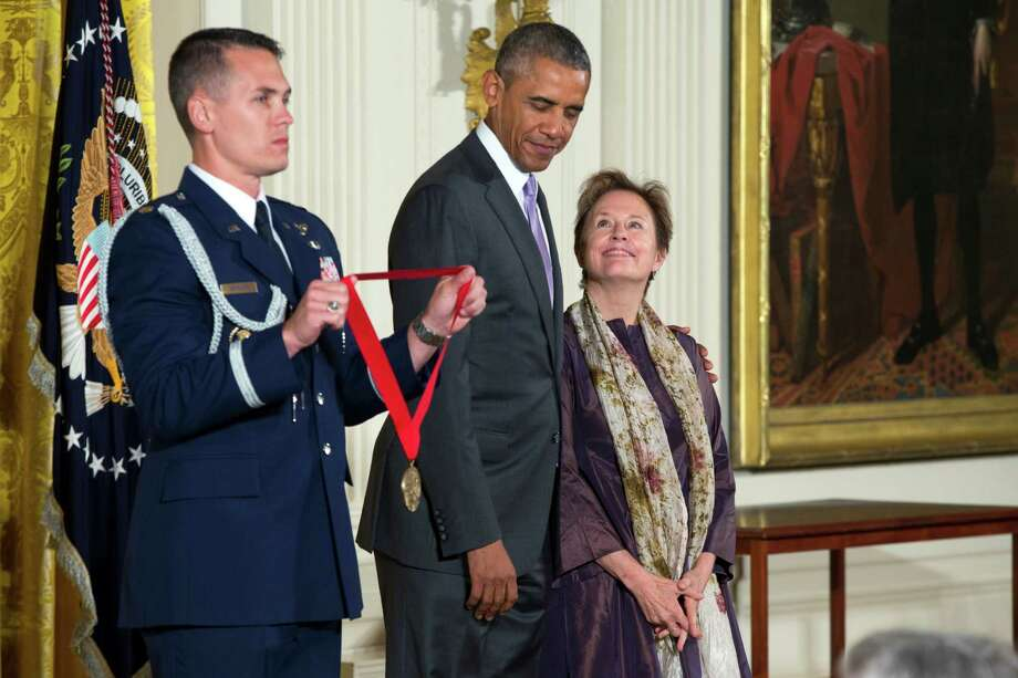 Chef, author and advocate Alice Waters of Berkeley (right) stands with President Obama before being presented with the National Humanities Medal in the East Room of the White House. Photo: Evan Vucci / Associated Press / AP