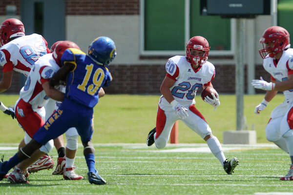 "With starting running back Tim Rhodes expected to miss the game, Lumberton will rely heavily on Keaton Upshaw to lead their rushing attack. Lumberton's Keaton Upshaw, No. 20, moves the ball up the field against Ozen on Saturday. The Ozen Panthers played against the Lumberton Raiders at the Carrol A ""Butch"" Thomas Educational Support Center on Saturday. Photo taken Saturday 9/27/14 Jake Daniels/@JakeD_in_SETX   Manditory Credit, No Sales, Mags Out, TV OUT, Web: AP Members Only"