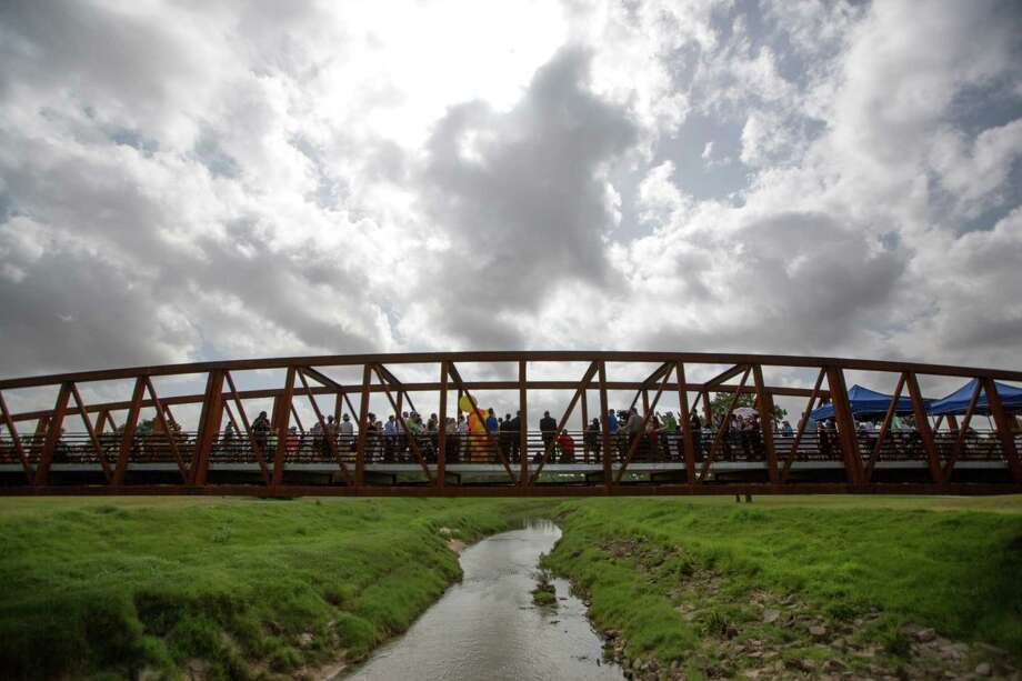 Mayor Annise Parker speaks during the opening of White Oak Bayou Path on July 9. On Thursday, she cited improvements to the hike-and-bike-trail system as one of many things that should make the city attractive to leisure travelers. Photo: Steve Gonzales, Staff / © 2015 Houston Chronicle