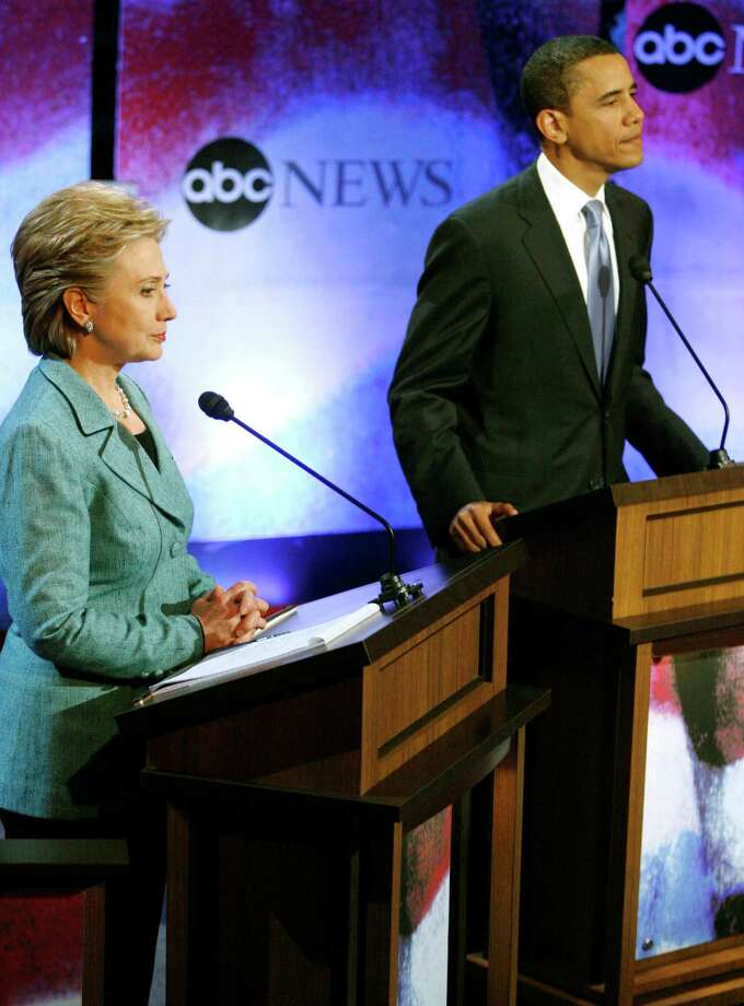 The Obama-Clinton feud had its beginnings in the 2008 presidential campaign. Sen.Hillary Clinton and Sen. Barack Obama stand at the podium during a break in the Democratic Presidential Debate at the National Constitution Center in Philadelphia in April 2008. Photo: TIM SHAFFER /REUTERS / X01383