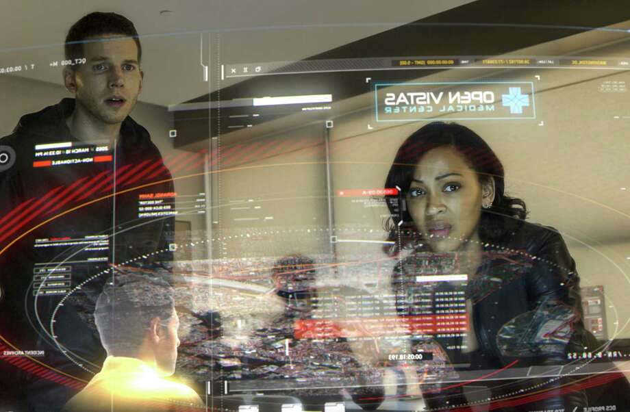 "Stark Sands (left) and Meagan Good appear in a scene from Fox's ""Minority Report."" Photo: Bruce MacCauley /Associated Press / Fox"