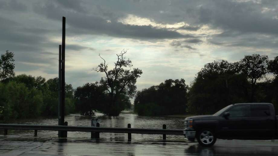 A golf course near Olmos Creek and McCullough Avenue flooded after as much as an inch of rain fell in one hour. Photo: John W Gonzalez