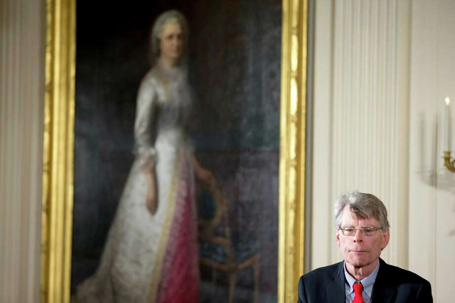 Author Stephen King of Bangor, Maine, stands on stage as President Barack Obama awards him the 2014 National Medal of Arts during a ceremony in the East Room at the White House in Washington, Thursday, Sept. 10, 2015. (AP Photo/Andrew Harnik) ORG XMIT: DCAH125 Photo: Andrew Harnik / AP