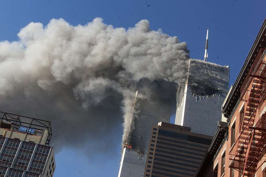 This Sept. 11, 2001 file photo shows smoke rising from the burning twin towers of the World Trade Center after hijacked planes crashed into the towers, in New York City.  Photo: Richard Drew, Associated Press