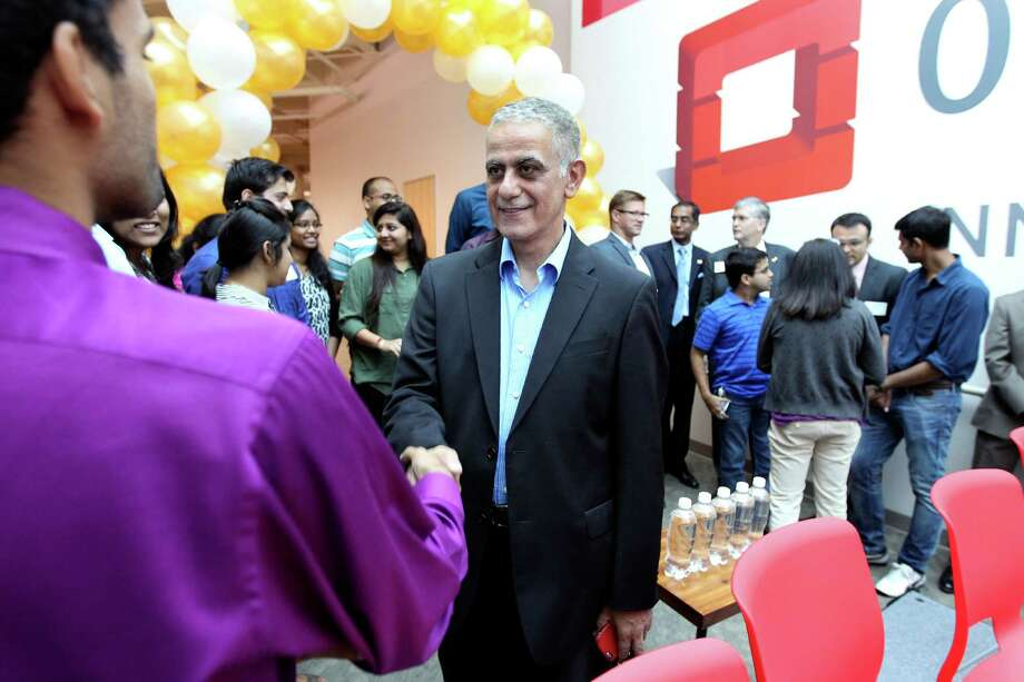 Imad Sousou, vice president of Intel's software and services group and general manager of Intel's Open Source Technology Center, talks with employees and interns Thursday at Rackspace about the newly launched partnership between Intel and Rackspace — the OpenStack Innovation Center. Photo: William Luther /San Antonio Express-News / © 2015 San Antonio Express-News