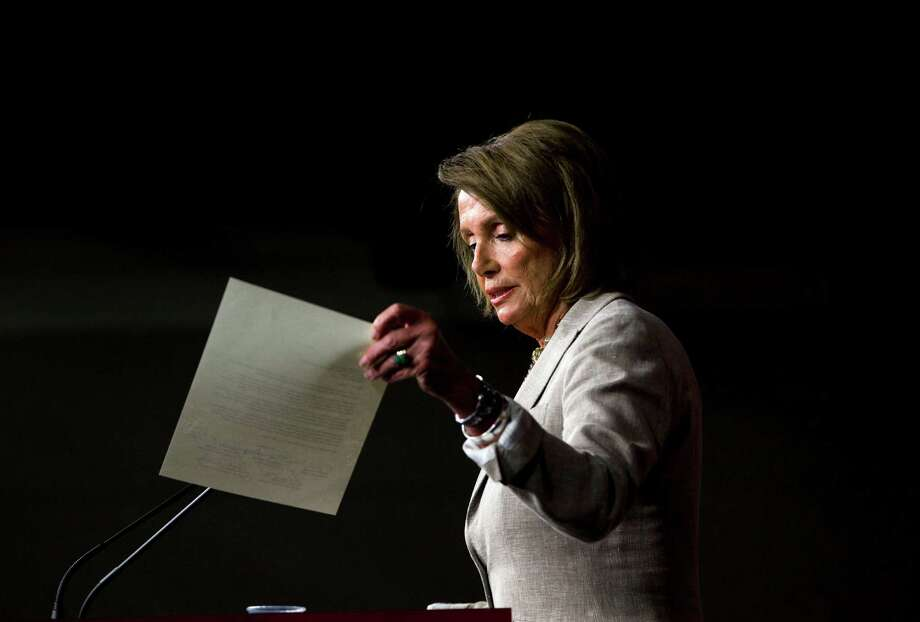 House Minority Leader Nancy Pelosi of Calif., holds up a letter, signed by members of the House Democratic leadership, that was sent to House Speaker John Boehner, as she speaks to reporters during her weekly news conference on Capitol Hill in Washington, Thursday, Sept. 10, 2015. (AP Photo/Pablo Martinez Monsivais) Photo: Pablo Martinez Monsivais, STF / Associated Press / AP