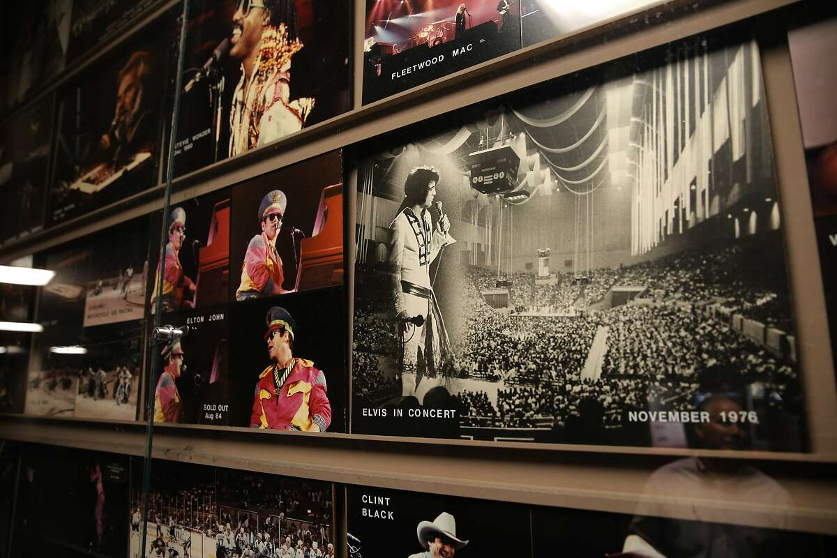 Photos of artists that have played the Cow Palace over the years include, Elton John, Elvis Presley and Stevie Wonder, are seen on the walls of the arena at the event center in Daly City, Calif., on Thurs. September 10, 2015.
