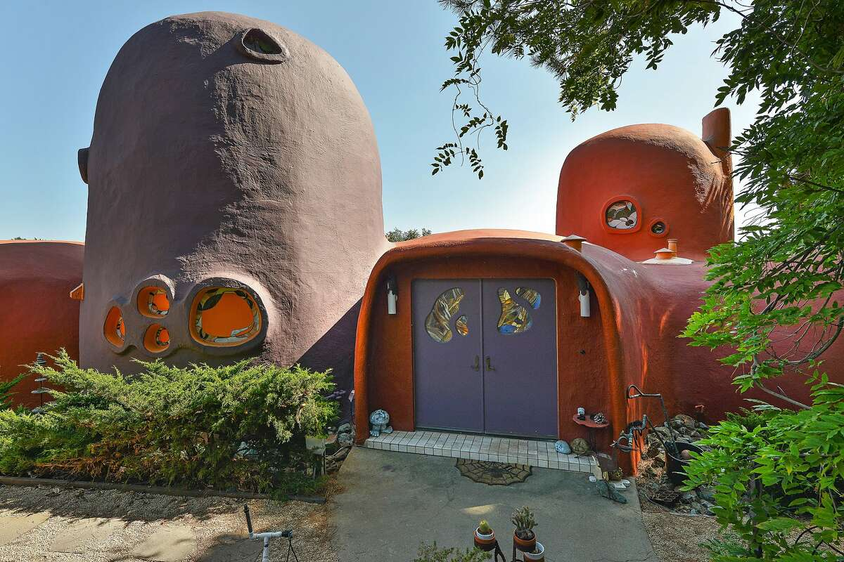 The Flintstone House received the orange and purple paint job in 2007.