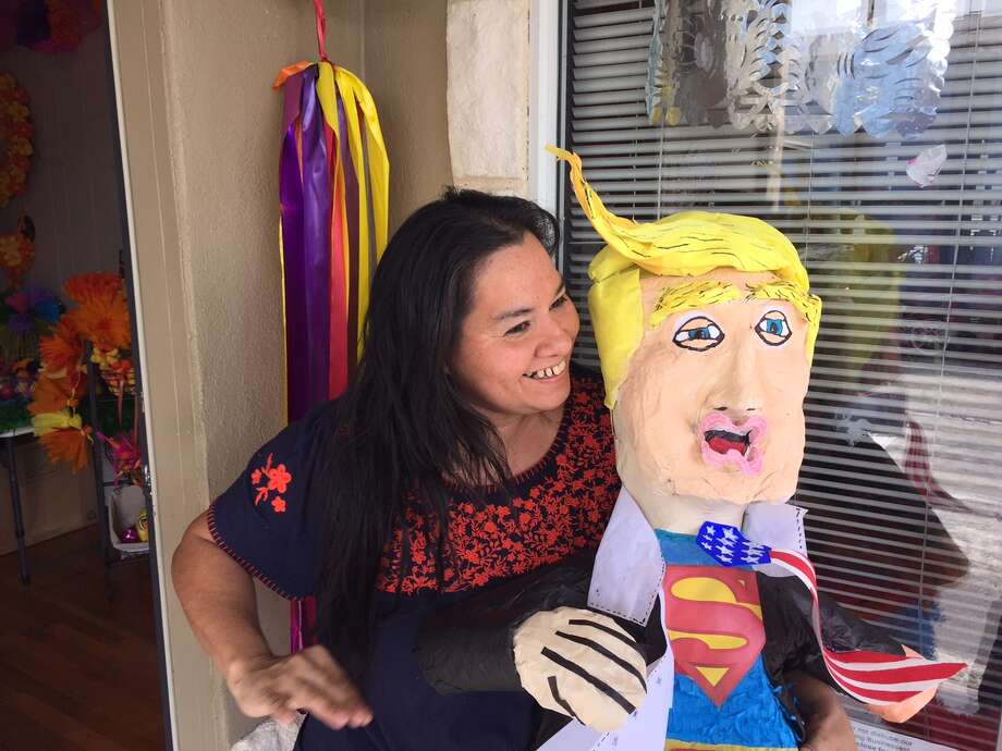 """Marylou Hernandez, owner of the Cascaron Store, made this Donald Trump piñata for a client. """"We just customize it to what they want."""" Photo: Hector Saldana"""
