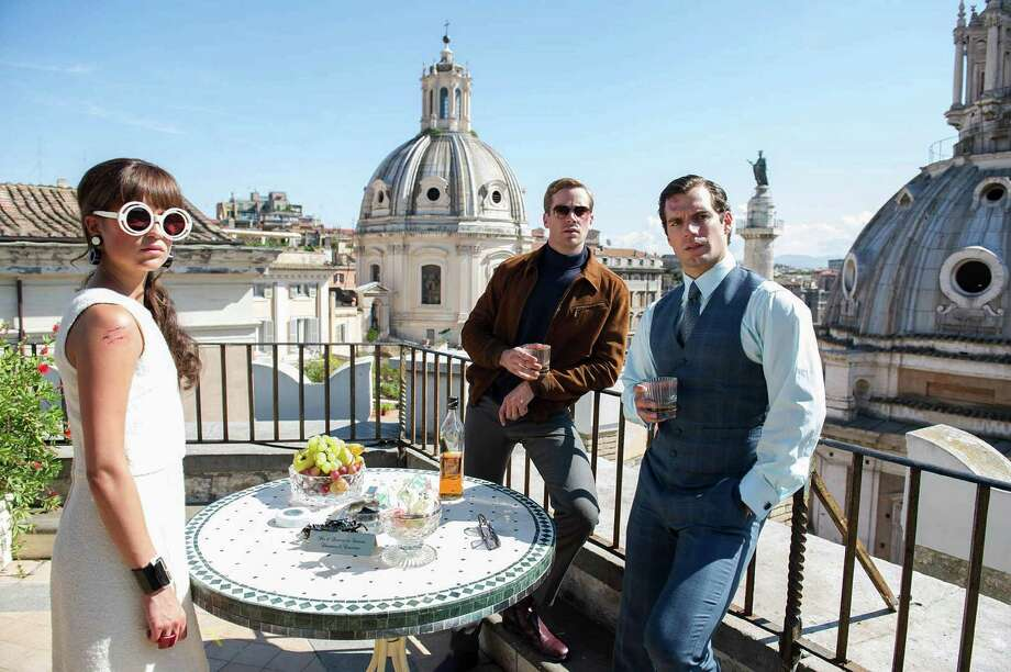 "This photo provided by Warner Bros. Pictures shows, Alicia Vikander, from left, as Gaby, Armie Hammer as Illya Kuryakin, Henry Cavill as Napoleon Solo, in Warner Bros. Pictures' action adventure ""The Man from U.N.C.L.E.,"" a Warner Bros. Pictures release. The movie opens  Friday, Aug. 14, 2015. (Daniel Smith/Warner Bros. Pictures via AP) ORG XMIT: CAET706 Photo: Daniel Smith / Warner Bros. Pictures"