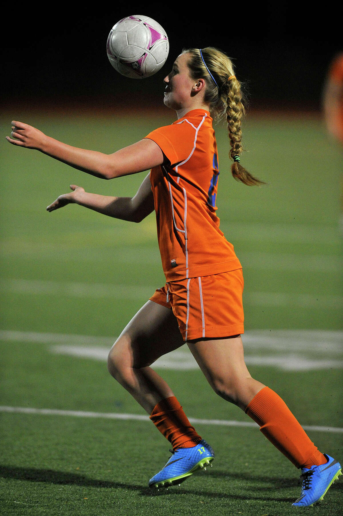 Danbury's Jessica Robbins heads the ball during the Hatters' FCIAC semifinal game against St. Joseph's at Norwalk High School in Norwalk, Conn., on Monday, Oct. 28, 2013.
