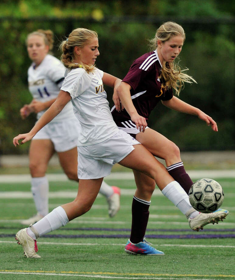 Westhill's Natalie Druehl battles St. Joseph's Julia Marino for the ball during their game at Westhill High School in Stamford, Conn., on Wednesday, Oct. 16, 2013. St. Joseph won, 4-1. Photo: Jason Rearick / Jason Rearick / Stamford Advocate