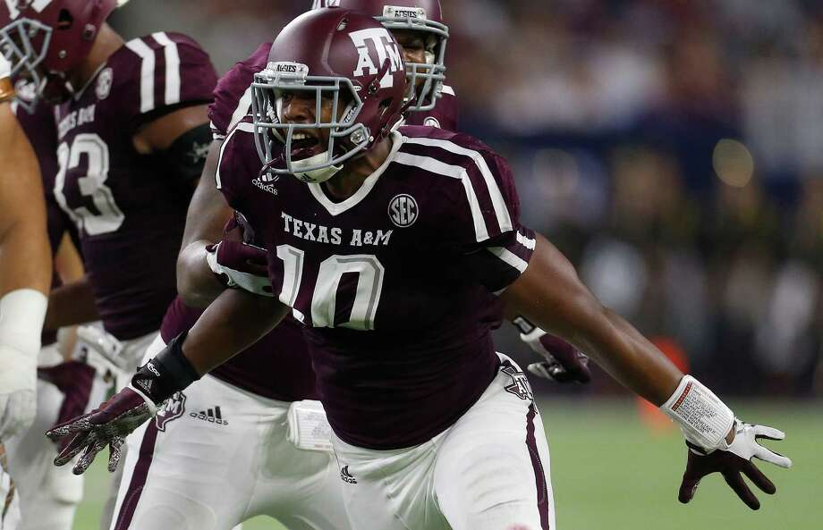 Texas A&M Aggies defensive lineman Daeshon Hall (10) celebrates a stop during the first half at NRG Stadium in Houston on Sept. 5, 2015. Photo: Karen Warren /Houston Chronicle / © 2015 Houston Chronicle