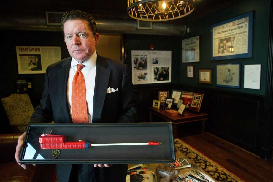 Attorney Dan Cogdell poses for a portrait holding a cattle prod in his office Friday, Feb. 1, 2013, in Houston. ( Brett Coomer / Houston Chronicle ) Photo: Brett Coomer, Houston Chronicle / © 2013 Houston Chronicle