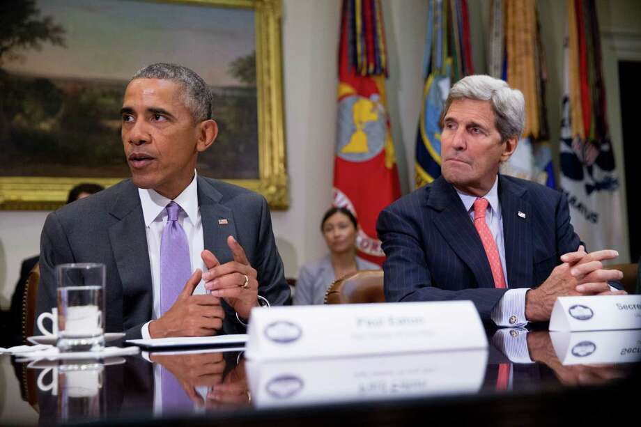President Barack Obama, accompanied by Secretary of State John Kerry, meets with veterans and Gold Star Mothers to discuss the Iran Nuclear deal, Thursday, Sept. 10, 2015, in the Roosevelt Room at the White House in Washington. (AP Photo/Andrew Harnik) ORG XMIT: DCAH104 Photo: Andrew Harnik / AP
