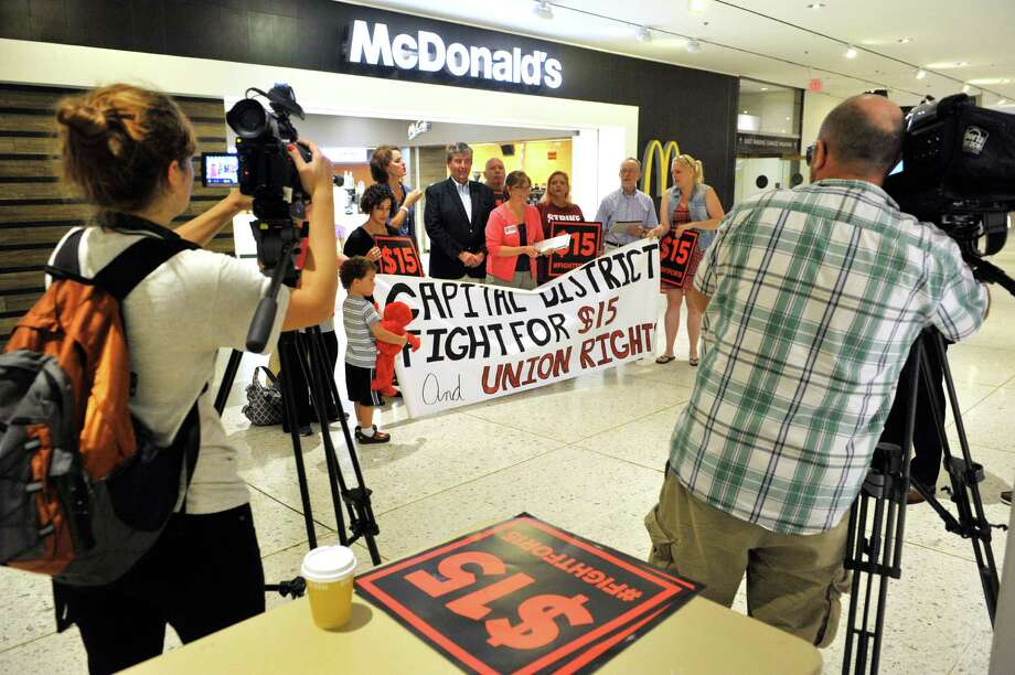 Supporters of a $15 minimum wage take part in a rally at the Empire State Plaza Concourse to call for a $15 minimum wage for all workers in New York State on Thursday, Sept. 10, 2015, in Albany, N.Y.  (Paul Buckowski / Times Union) Photo: PAUL BUCKOWSKI / 00033323A