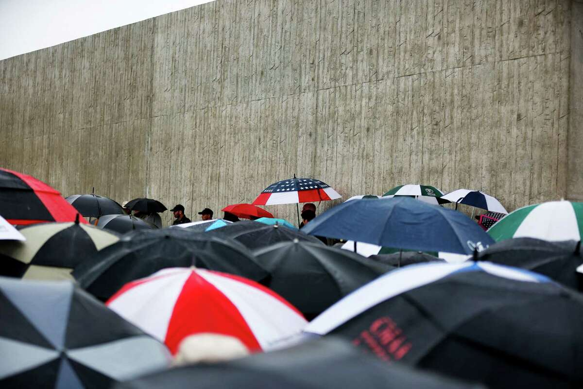 Umbrellas cover family and friends of the 40 crew and passengers of United Flight 93 as rain falls during the Flight 93 National Memorial Visitor Center dedication ceremony in Shanksville, Pa., on Thursday, Sept. 10, 2015. Sitting on a hill overlooking the crash site, the $26 million visitor center complex opened to the public on Thursday, one day before the annual 9/11 observances in Pennsylvania, New York and Washington. (AP Photo/Gene J. Puskar) ORG XMIT: PAGP106