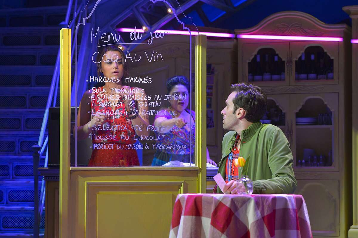Amelie (Samantha Barks, left), with Suzanne (Maria-Christina Oliveras), catches sight of Nino (Adam Chanler-Berat) in Berkeley Rep's