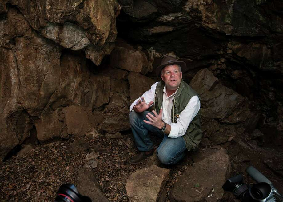 Professor Lee Berger is seen inside the entrance to the Rising Star cave, where Homo naledi's bones were discovered. (Brett Eloff/Courtesy University of the Witwatersrand/TNS) Photo: Brett Eloff, HO / McClatchy-Tribune News Service / University of the Witwatersrand