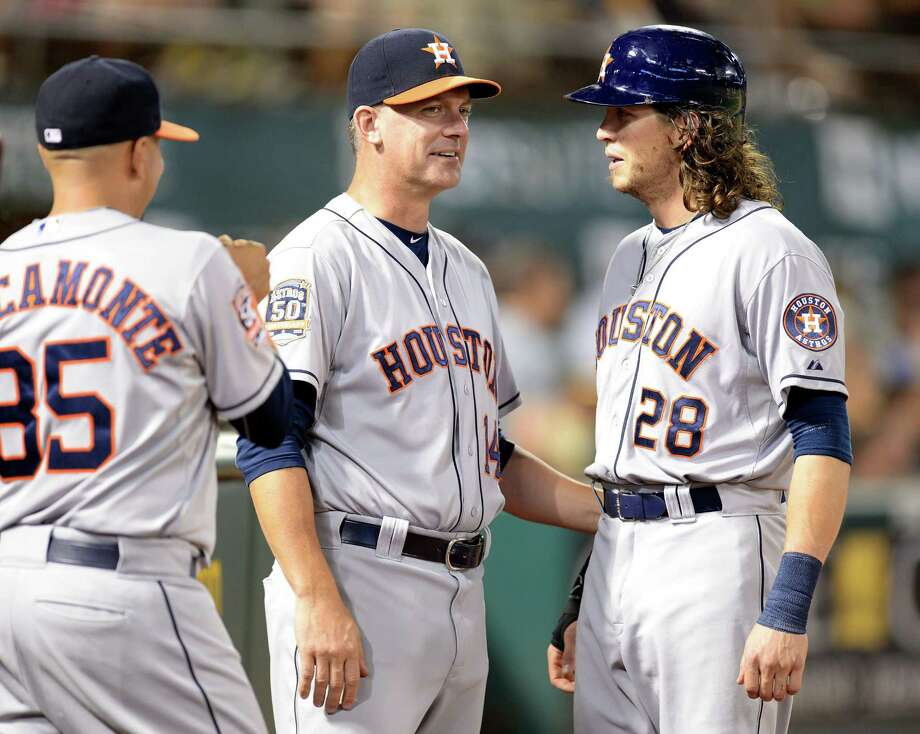 Behind an influx of new blood like manager A.J. Hinch, center, and Colby Rasmus, right, the Astros have positioned themselves for a playoff push following a string of losing seasons. Photo: Susan Tripp Pollard, Tribune News Service / Contra Costa Times