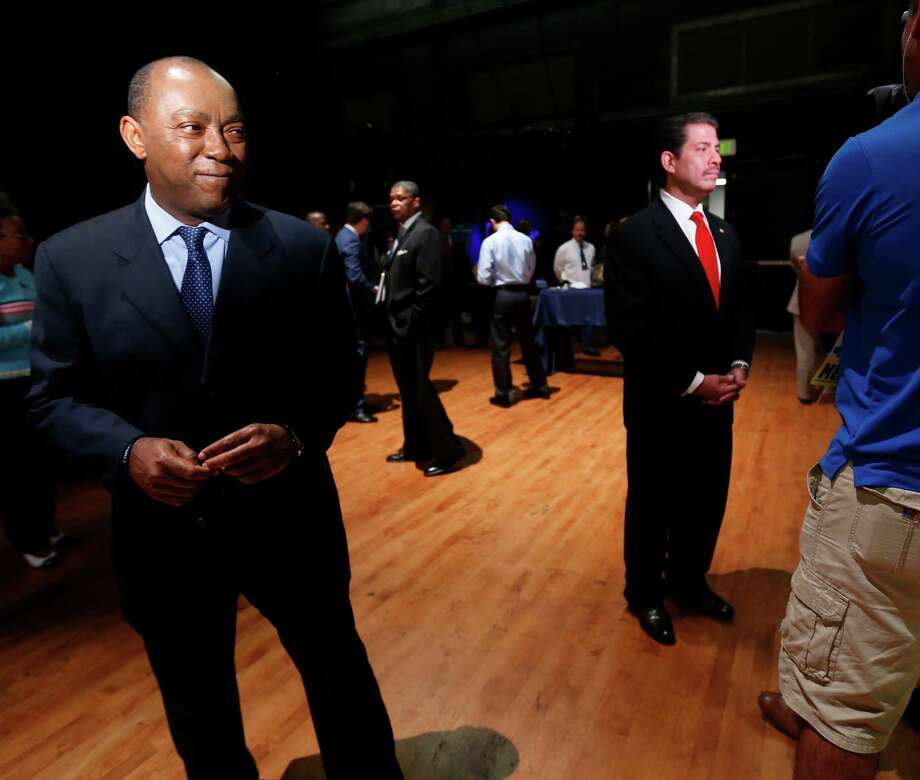 Mayoral candidate Sylvester Turner, waits his turn as Adrian Garcia does his one-on-one interview with the media after the Houston Mayoral debate at the Hobby Center on Thursday, Sept. 10, 2015. Both Garcia and Turner lead in new survey, with 19 percent each. Photo: Karen Warren, Houston Chronicle / © 2015 Houston Chronicle