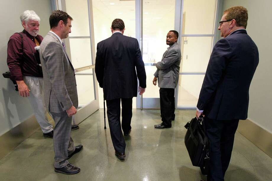HISD Superintendent Terry Grier, center, exited the district's central office after announcing Sept. 10 that he was resigning effective 2016. (Steve Gonzales / Houston Chronicle) Photo: Steve Gonzales, Staff / © 2015 Houston Chronicle