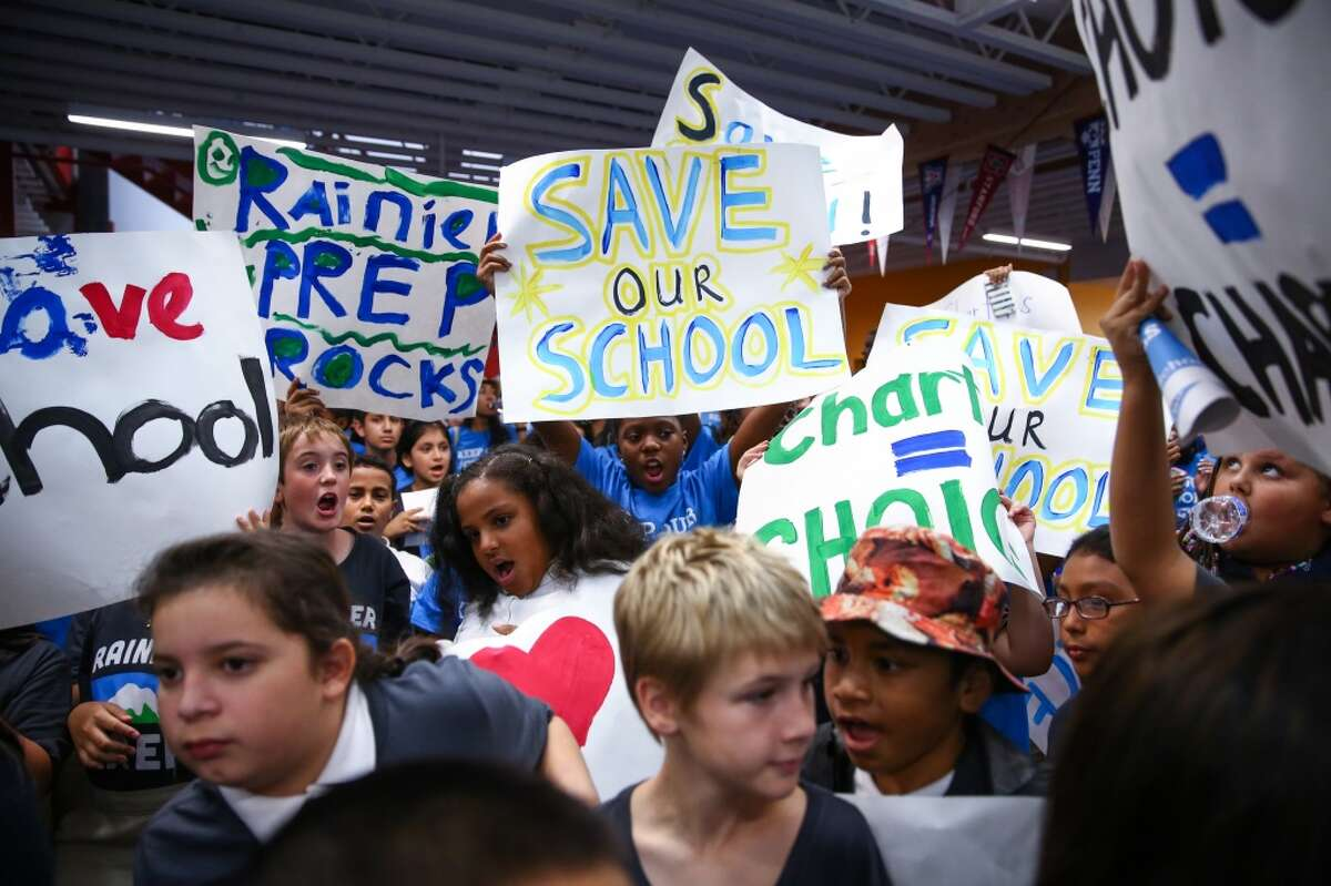 Hundreds of students rally at Summit Sierra public charter school in Seattle's International District. Charter school students, parents and staff rallied to support the schools and to call for Governor Jay Inlsee and the legislature to show their support. Photographed on Thursday, September 10, 2015. (Joshua Trujillo, seattlepi.com)