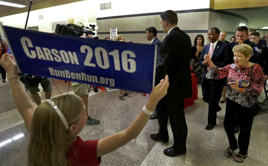 Republican presidential candidate Ben Carson is greeted by supporters Thursday for his speech at Conroe High School. Photo: Melissa Phillip, Staff / © 2015 Houston Chronicle