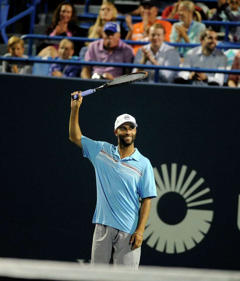 In this Thursday, Aug. 27, 2015, photo, James Blake gestures during an exhibition match at the Connecticut Open tennis tournament in New Haven, Conn. Former tennis star James Blake said Thursday, Sept. 10, 2015,  he wants an apology after a case of mistaken identity led police to handcuff him and take him to the ground, but New York's police commissioner said Blake hasn't returned his calls. (AP Photo/Fred Beckham) Photo: Fred Beckham / Associated Press / FR153656 AP