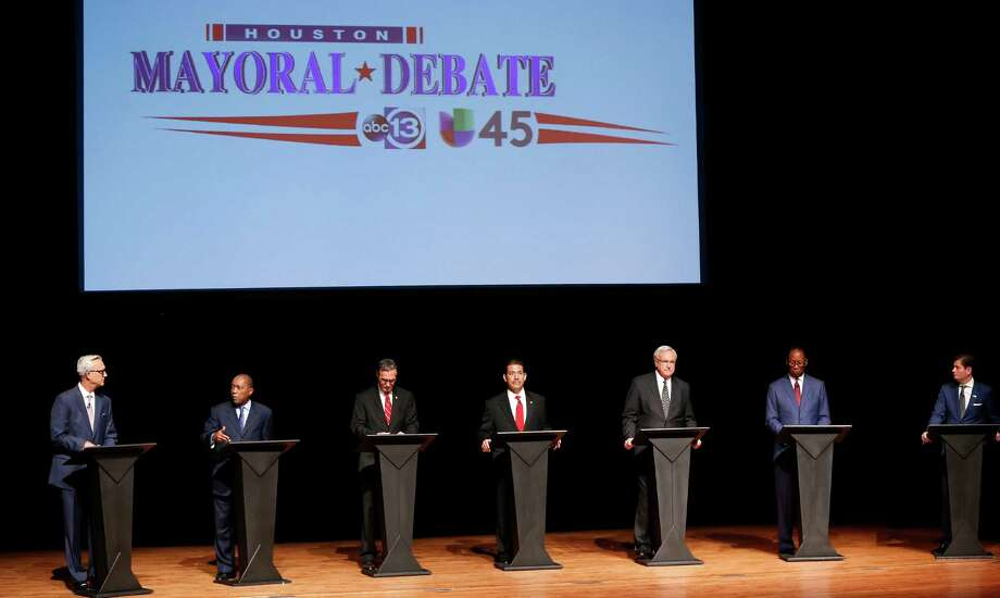 Mayoral candidates, from left, Chris Bell, Sylvester Turner, Steve Costello, Adrian Garcia, Bill King, Ben Hall and Marty McVey take the stage during the first televised mayoral debate at the Hobby Center on Thursday. Photo: Karen Warren, Staff / © 2015 Houston Chronicle