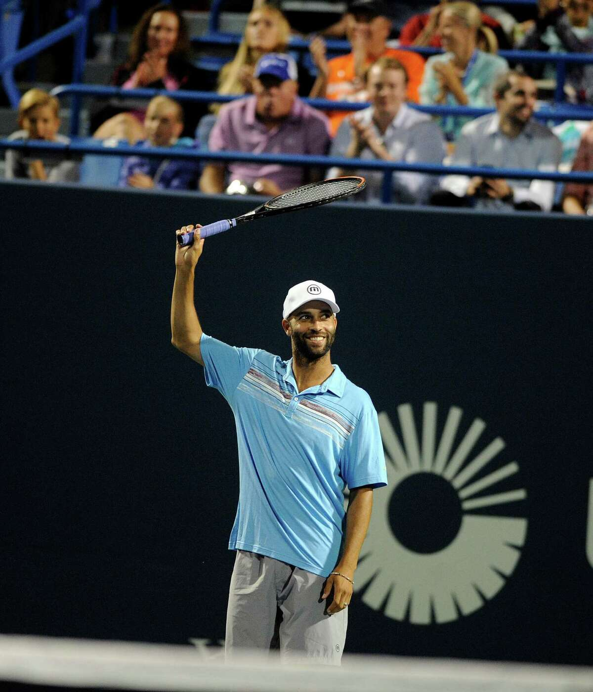 In this Thursday, Aug. 27, 2015, photo, James Blake gestures during an exhibition match at the Connecticut Open tennis tournament in New Haven, Conn. Former tennis star James Blake said Thursday, Sept. 10, 2015, he wants an apology after a case of mistaken identity led police to handcuff him and take him to the ground, but New York's police commissioner said Blake hasn't returned his calls. (AP Photo/Fred Beckham)