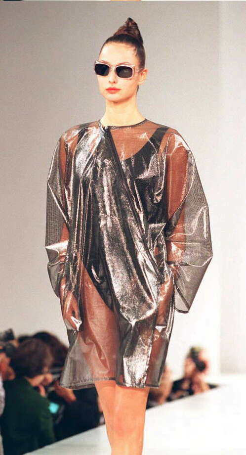 A model wears a sheer coat over a black bathing suit during the  Spring 1996 Yeohlee fashion show 30 October in New York. Fashion week began 29 October with the top designers exhibiting through 03 November. Photo: TIMOTHY CLARY, Getty / AFP