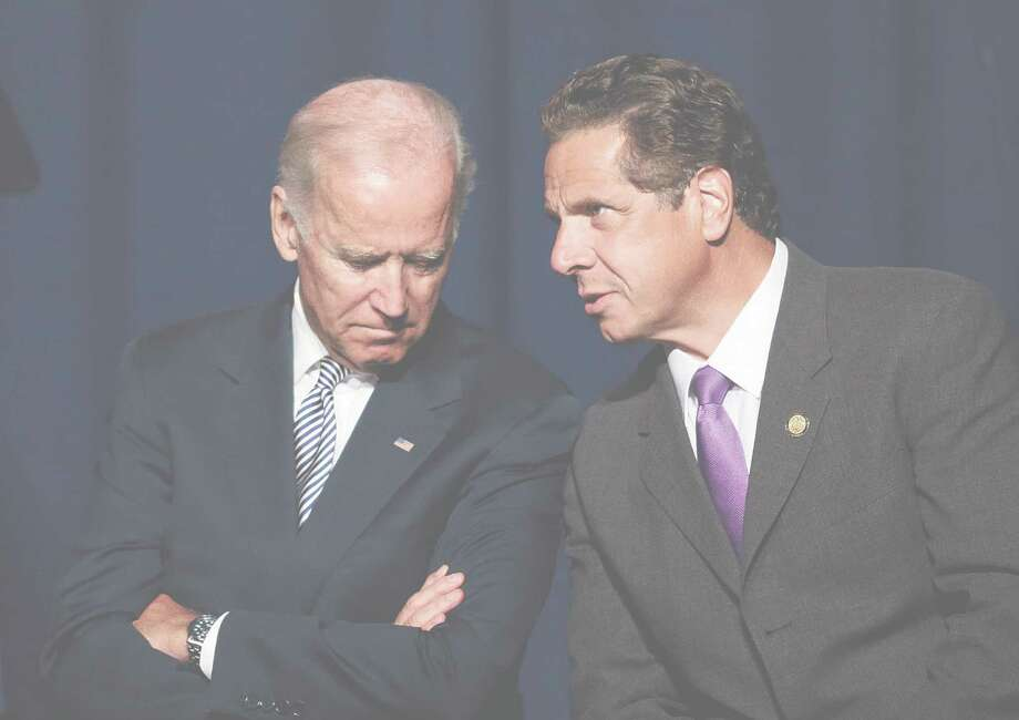 Vice President Joe Biden and New York Gov. Andrew Cuomo confer prior to speaking at a labor rally. Photo: Mark Lennihan, STF / AP