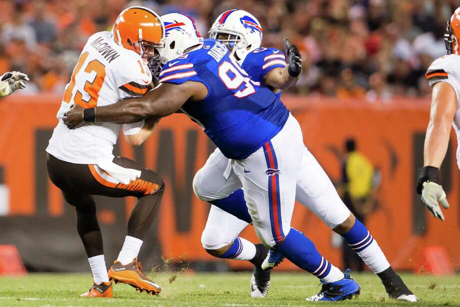 CLEVELAND, OH - AUGUST 20: Quarterback Josh McCown #13 of the Cleveland Browns is sacked by defensive tackle Marcell Dareus #99 of the Buffalo Bills during the first half of a preseason game at FirstEnergy Stadium on August 20, 2015 in Cleveland, Ohio. (Photo by Jason Miller/Getty Images) ORG XMIT: 565482537 Photo: Jason Miller / 2015 Getty Images