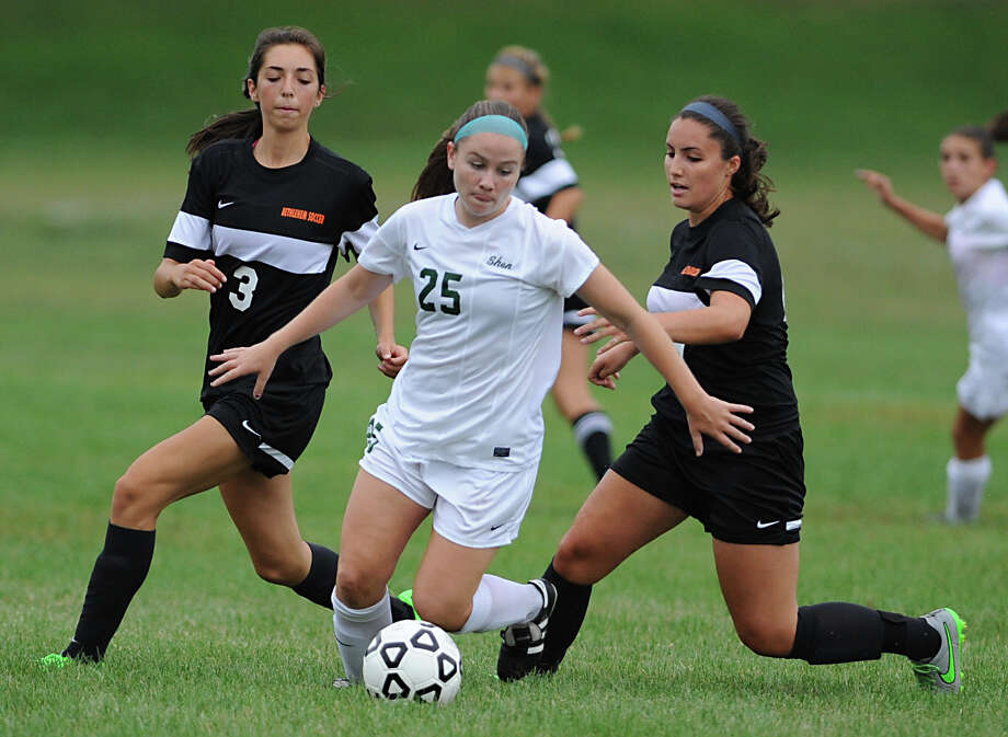 Shenendehowa's Meghan Cavanaugh, #25, breaks away from Bethlehem's Holly Moore, left, and Callie Noonan, right, as they battle for the ball during a soccer game on Thursday, Sept. 10, 2015 in Clifton Park, N.Y. (Lori Van Buren / Times Union) Photo: Lori Van Buren / 00033266A