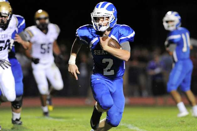 Shaker's Mike Stiso, center, carries ball as during their football game against Christian Brothers Academy on Friday, Sept. 4, 2015, Shaker High in Latham, N.Y. (Cindy Schultz / Times Union) Photo: Cindy Schultz / 00033230A