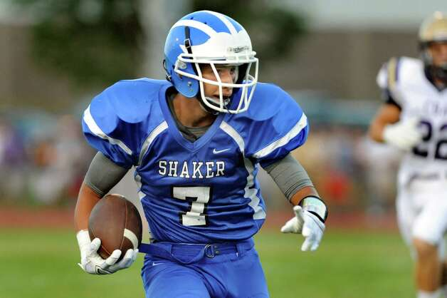 Shaker's Kyle Kessler, left, carries ball as during their football game against Christian Brothers Academy on Friday, Sept. 4, 2015, Shaker High in Latham, N.Y. (Cindy Schultz / Times Union) Photo: Cindy Schultz / 00033230A