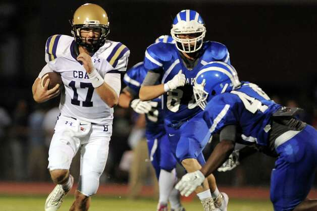CBA's quarterback Joe Kolbe, left, carries the ball during their football game against Shaker on Friday, Sept. 4, 2015, Shaker High in Latham, N.Y. (Cindy Schultz / Times Union) Photo: Cindy Schultz / 00033230A