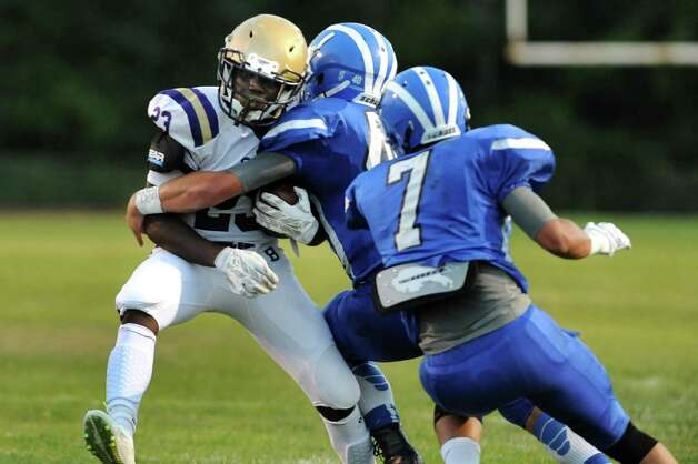 CBA's Taurian Taylor, left, carries the ball as Shaker's Kwasi Addo, center, defends during their football game on Friday, Sept. 4, 2015, Shaker High in Latham, N.Y. (Cindy Schultz / Times Union) Photo: Cindy Schultz / 00033230A