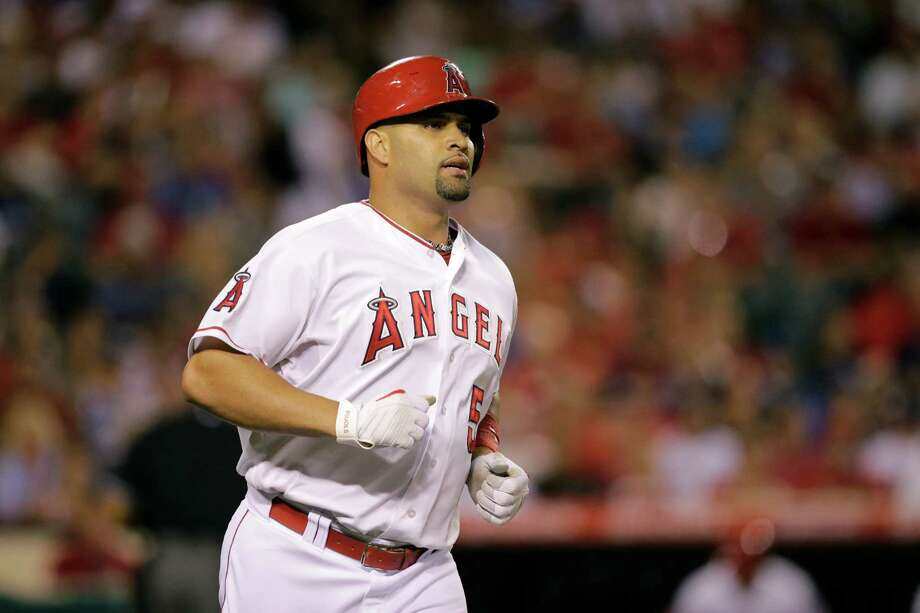 Los Angeles Angels' Albert Pujols watches his fly ball during the fourth inning of a baseball game against the Los Angeles Dodgers, Tuesday, Sept. 8, 2015, in Anaheim, Calif. (AP Photo/Jae C. Hong) Photo: Jae C. Hong, STF / AP