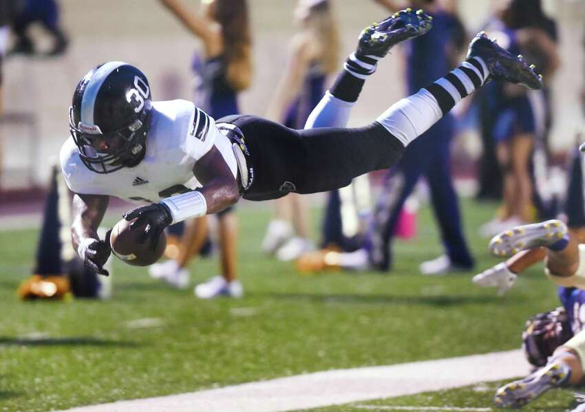 Steele running back Travell Lumpkin dives into the end zone for a first-half touchdown against O'Connor during high school football action at Farris Stadium on Thursday, Sept. 10, 2015.