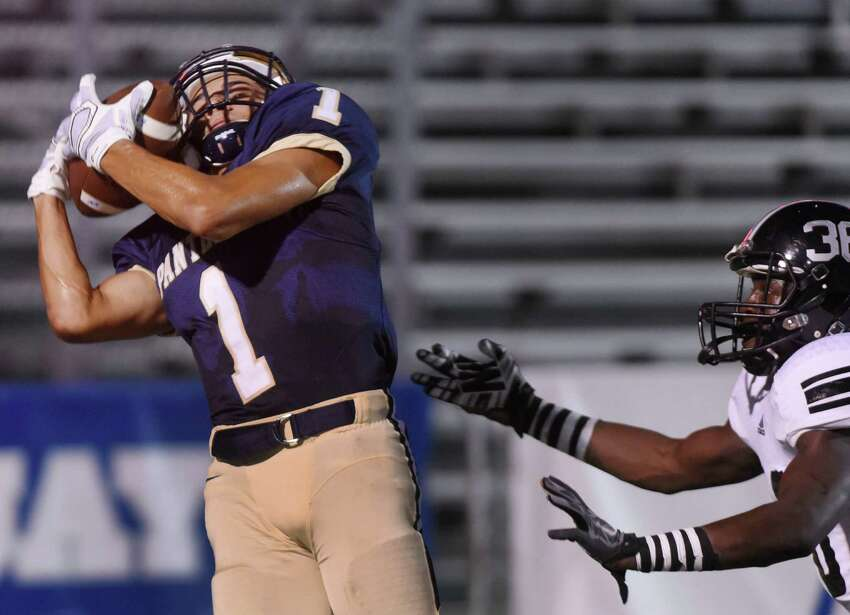 O'Connor receiver Jonathan Tapia catches a touchdown pass during high school football action against Steele's Imond Woods at Farris Stadium on Thursday, Sept. 10, 2015.
