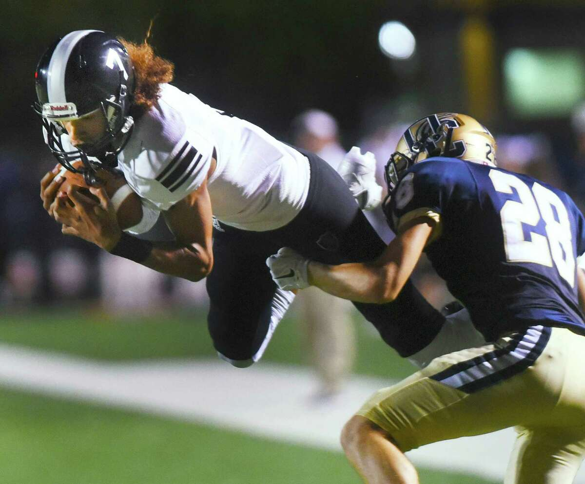 Steele receiver Antoine Cox-Wesley catches a pass as O'Connor's Steven Charo defends during high school football action at Farris Stadium on Thursday, Sept. 10, 2015.